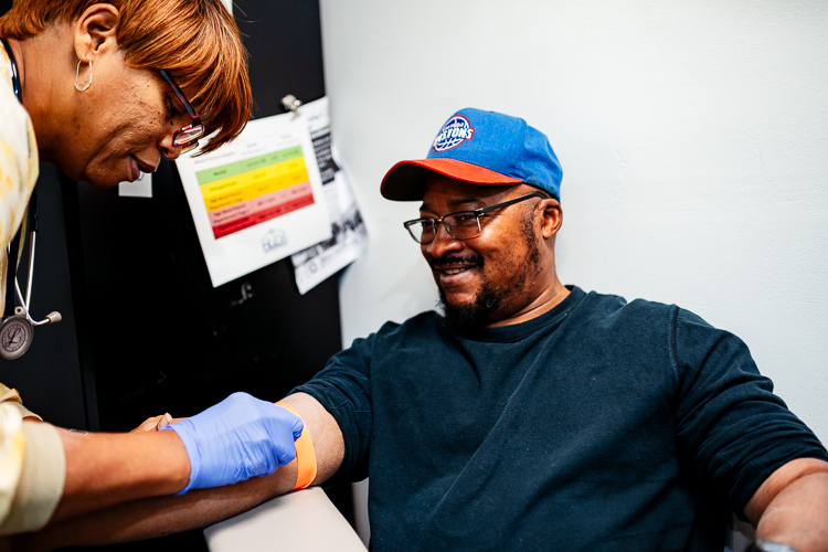 About HUDA Clinic | Detroit Community Health Center - william_butler_is_prepared_to_get_his_blood_drawn_by_his_nurse_val_gamble